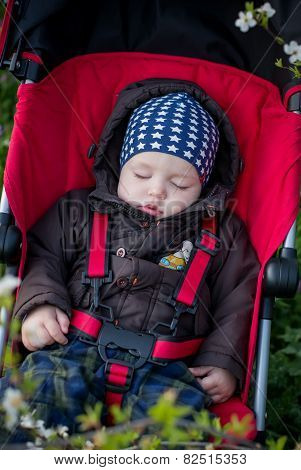 Toddler Child Is Sleeping In The Stroller