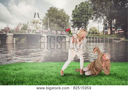 Angry woman attacking partner with rose bouquet against sunny day by the river
