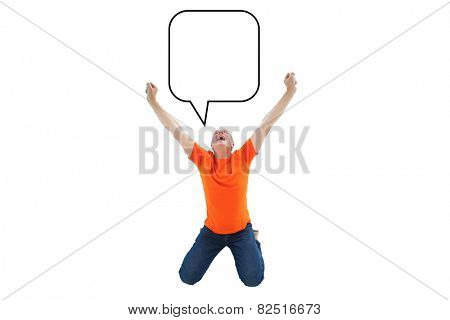 Mature man in orange tshirt cheering while kneeling against speech bubble