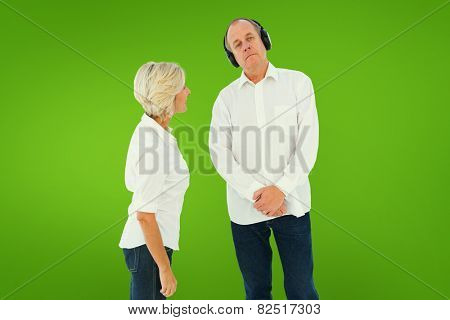 Annoyed woman being ignored by her partner against green vignette