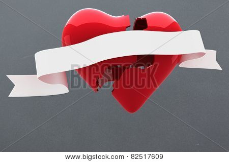 Broken heart against grey