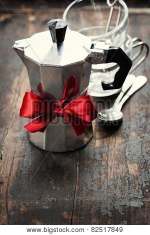 Coffee maker and cups on wooden background
