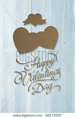 Valentines day greeting against bleached wooden planks background