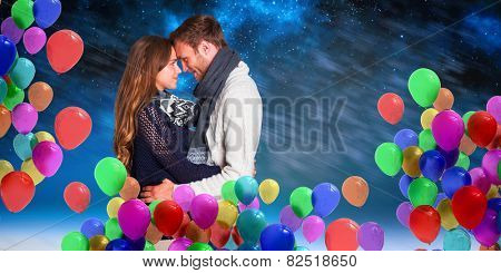 Side view of young couple embracing against aurora night sky in blue