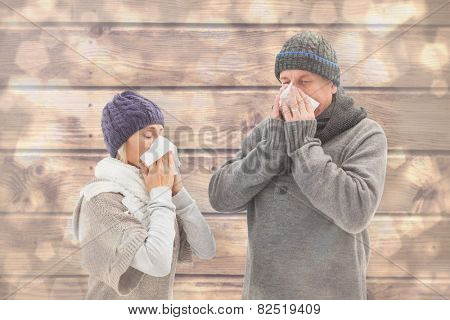Sick mature couple blowing their noses against light glowing dots design pattern