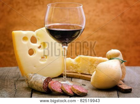 Red Wine With Cheese Selection And Salami