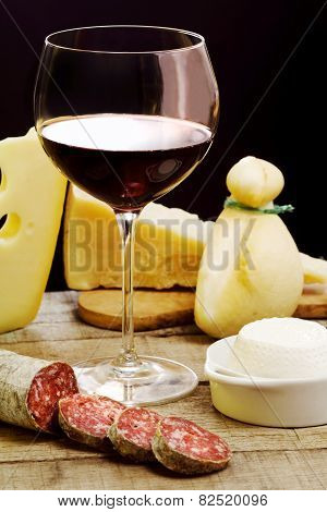 Selection Of Dairy Product, Salami And Red Wine