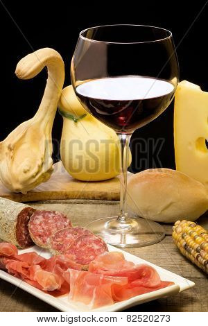 Cheese, Ham And Wine With Autumnal Decorations