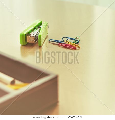 Green Stapler And Paper Clip