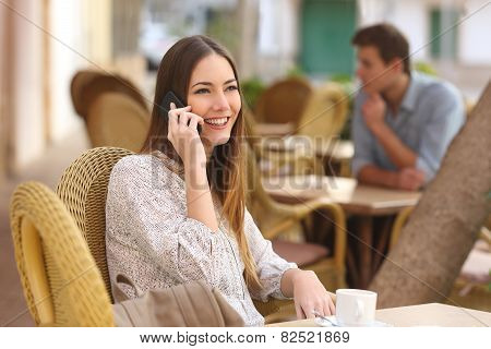 Happy Woman Calling On The Phone In A Restaurant