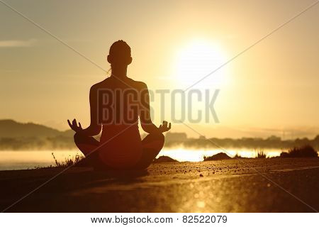 Silhouette Of A Fitness Woman Exercising Yoga Meditation Exercises