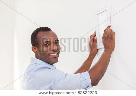 Man Hanging Picture Frame