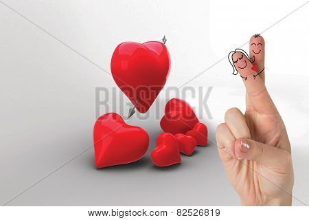 Fingers crossed like a couple against love hearts