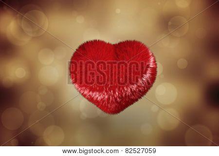 Red heart against orange abstract light spot design