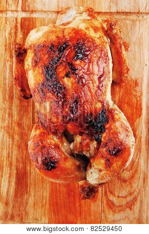 poultry : homemade roast whole turkey on wooden cutting board isolated over white background