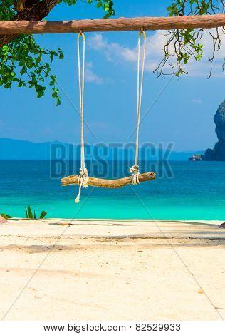 Seaside Swing Under the Trees
