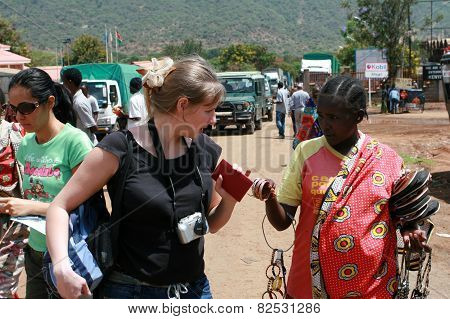 Black Woman Native Offers European Tourists Buy Souvenirs Production Masai.