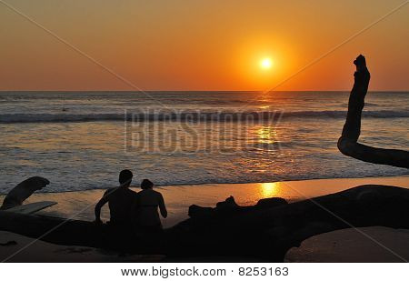 Beach Sunset with Couple' Silhouette