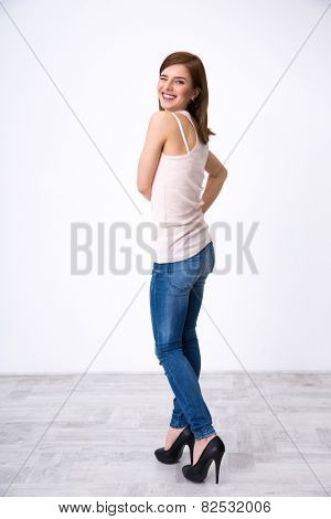 Back view portrait of a happy woman winking at camera
