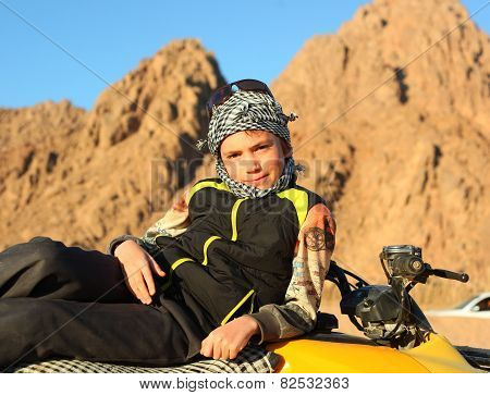 Handsome Preteen Boy On Quad Bike Safari Trip