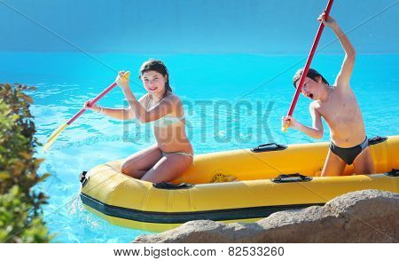 Siblings Preteen Girl And Boy In Rubber Boat With Raw In Egyptian Open Air Water Park
