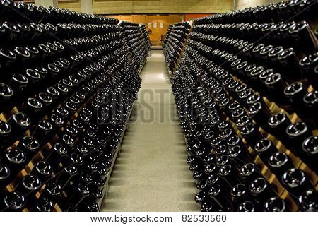 Lots of wine bottles stacked