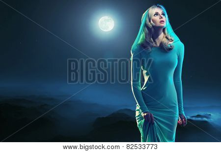 Mysterious blonde beauty in the moonglight