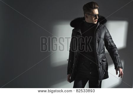 Fashionable young man posing