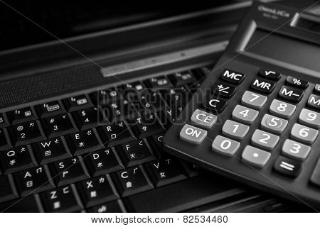 Image of computer and calculation