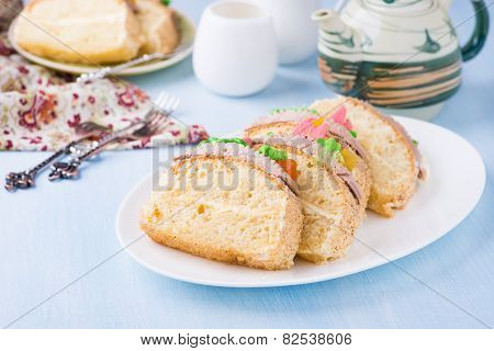 Slices Of Sponge Cake With Buttercream On Plate