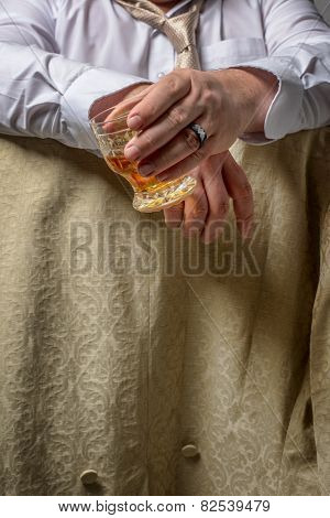 Man drinking a glass of spirits
