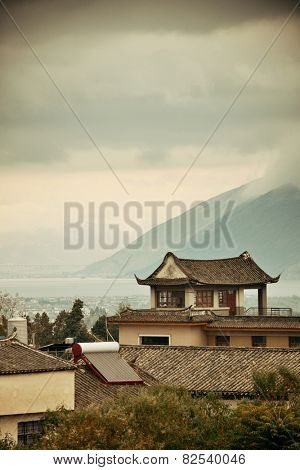 Dali Old Town with misty mountain and historical buildings in Yunnan, China.