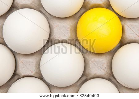 white eggs with one gold egg
