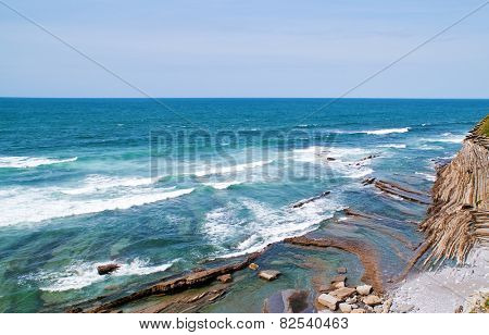 blue ocean and high cliff