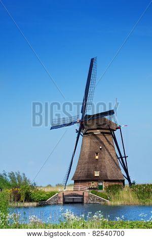 View of windmill on arrogation channel in Holland