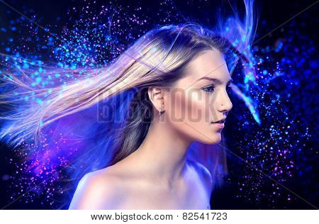 Fashion Model Girl Portrait with Long Blowing Blond Hair. Glamour Beautiful Woman with Healthy and Beauty Blonde Hair over dark night background. Flying long hair