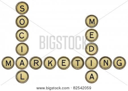 social media marketing - crossword  in old round typewriter keys isolated on white