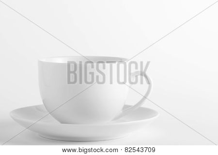 White cup and saucer on a white background