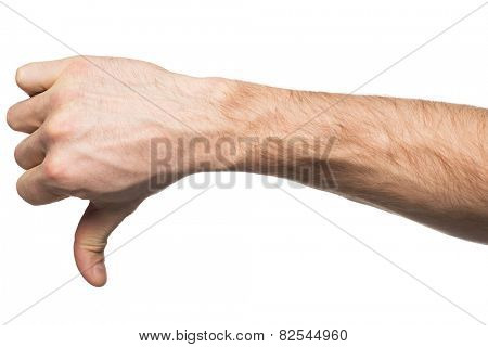 Closeup of male hand gesture dislike with thumb down. Isolated on white background