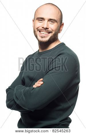 Studio portrait of happy young man with crossed arms, isolated on white background