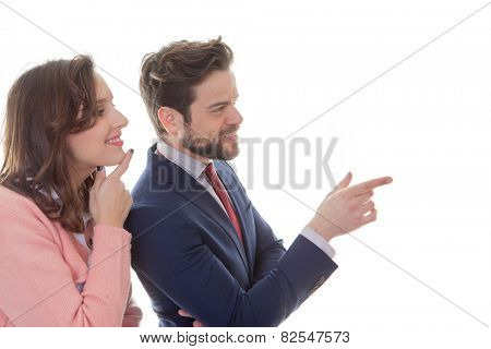 young business people pointing in meeting