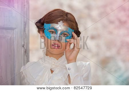 innocent young  woman with face masquerade mask