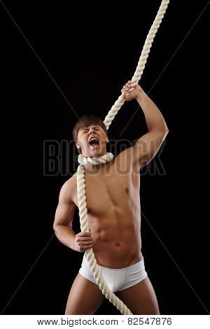 Brawny man strangles himself with rope