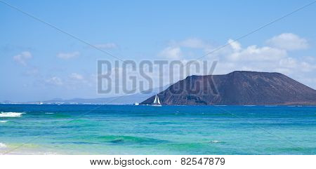 Northern Fuerteventura, View Towards Isla De Lobos, Small White Yacht In Front Of It