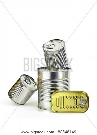 Closed cans of conserved food over a white background