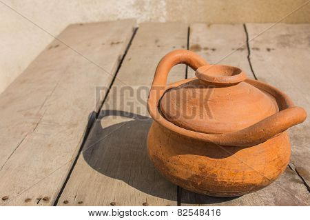 Clay Pot On A Wooden