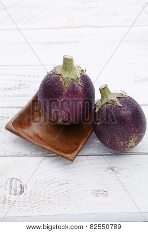 close up of the egg plant with water plant