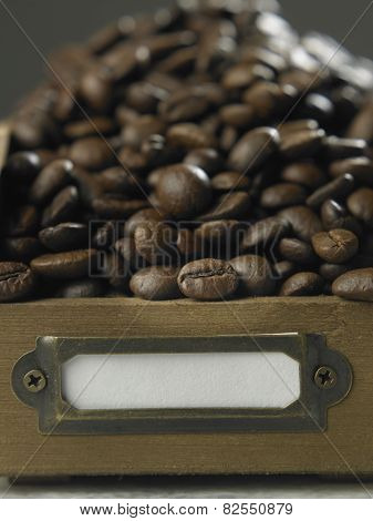 Close up roasted coffee bean in the wooden container