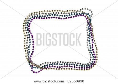 Shiny Gold, Purple, Blue And Silver Mardi Gras Beads On White Background. Symbol Of New Orleans