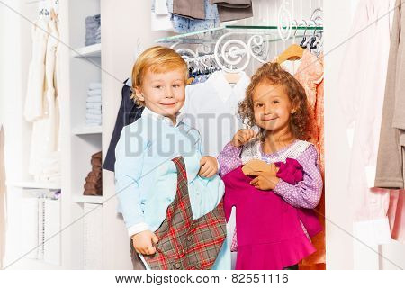 Smiling boy with vest and girl shopping together